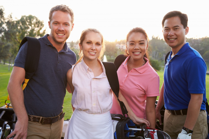 Stock photo of four golfers